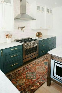 Mama - These GREEN/BlUE cabinets reminded me of you. You should paint your cabinets with a bold color like this; something that would pull out the color in the oriental rug you have in there (I think you swapped out rugs long ago, but you could swap back & add that small Oriental ? rug?), and pull it all together..