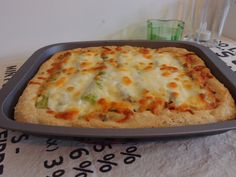 Sun-dried tomato and asparagus deep pan pizza with lemon
