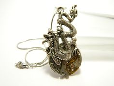Silver colored steampunk necklace The dragon by EmilySteampunk