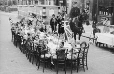 Children enjoy a street party to celebrate the end of the war in 1945.