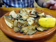 A plate of freshly cooked setas mushrooms in Madrid