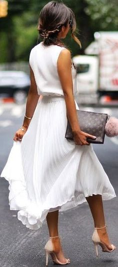 Pleated midi + neutral heels.
