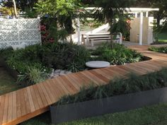 Easy visitor access with a ramped #deck through the garden #backyarddeckonabudgetpatiomakeover