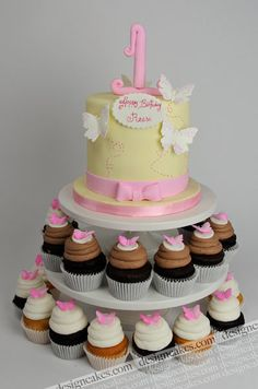 small 1st bday cake with cupcake stand