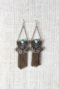 Ancient Semi-Circle Fringe Chain Earrings - Bronze Description These  earrings  feature a semi-circle with tribal designs, a turquoise stone center, and coin charms. Finished with curb link chain fringe and French hook backs.   Measurement Measure approx. 2.3  L x 1.1 W. UNG61841BRN   http://p.nembol.com/p/EJWc5WWSTl Published via Nembol app