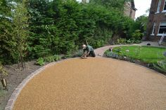 Resin bound gravel patio in Wilmslow, Cheshire. Designed and delivered by Creative Gardens and Driveways, Bramhall, Cheshire. Rock Driveway, Resin Driveway, Resin Patio, Asphalt Driveway, Driveway Paving, Driveway Design, Driveway Landscaping, Landscaping With Rocks, Driveway Ideas