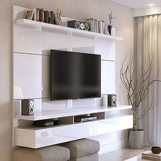 """City 62.99"""" Floating Entertainment Center In White - The City Floating Entertainment Center creates a sophisticated theatrical vibe for your living room. This piece features built-in brackets to conveniently hang your TV, 3 media shelves, and 2 spacious cubbies with flip-down doors."""