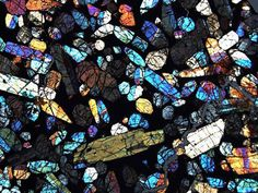 A microscopic image of a slice of a meteorite. The various colors indicate the sizes, shapes and orientations of minerals in the rock. (Credit: Image courtesy of NASA) Life On Mars, Thing 1, Cool Rocks, Science And Nature, Science Daily, Science News, Earth Science, Heaven On Earth, Rocks And Minerals