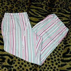 Victoria's Secret PJ bottoms Very gently used VS drawstring pajama pants with a cute striped pattern with silver shimmery threads(Shown in 3rd picture)  Also has two pockets which not many PJ bottoms have! Excellent condition. Size XL Short (perfect length for anyone under 5'5) Make an offer!!!  Victoria's Secret Intimates & Sleepwear Pajamas