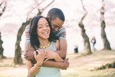 A beautiful Washington, DC engagement session with Cherry Blossoms at the Tidal Basin. Images by Paula Bartosiewicz.