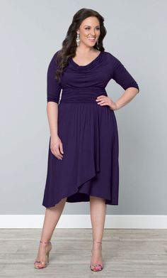 Lovely purple plus size draped dress is soft jersey! Wear this flattering dress to look awesome at work or that special event!
