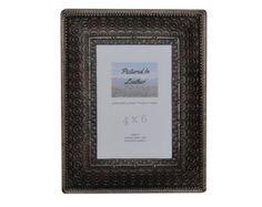 $44   A 4x6 black leather picture frame embossed with a circles design. A very unique design and also very beautiful. Perfect for your rustic decor or elegant decor. We have a Plexiglas and an easel back in this so it's ready for you or get it for a special gift!