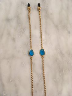 The Marie glasses chain. Simple, elegant, blue faceted gems on a gold-tone chain. Put a cute chain on your eyeglasses or sunglasses so that you dont lose them or stretch them out on top of your head. Why put on some tacky croakies or other boring chain when you can join the #YbyHY chain gang with a sparkly, pretty, handmade, one of a kind masterpiece using only high-quality elements and genuine gemstones! All chains are wired by hand--the eyeglass chain end is a woven elastic cord and…