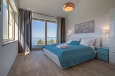 You can even wake up to this breathtaking view, as each bedroom has a sea view, as well. Apart from that, each of the bedrooms is equipped with its own TV and ensuite bathroom, in order to offer you the luxury that you are looking for. Heated Pool, Winter Holidays, Bedrooms, Villa, Luxury, Summer, Sea, Furniture, Bathroom