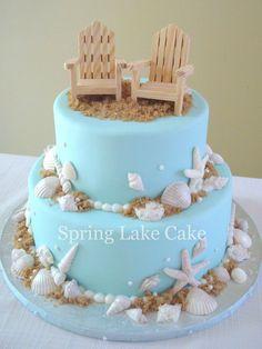 Beach themed wedding cake with chocolate shells.