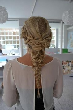 pretty braid- I don't care for fancy braids, but This would look so pretty with my curly hair and purple highlights :)