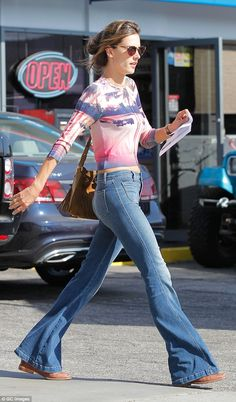 Alessandra Ambrosio.. Minnie Rose Tencel Cotton Palm Tree top, Saint Laurent Suede Fringe Emmanuelle Bucket Bag, and J Brand Demi Flare Jeans in Ashbury..