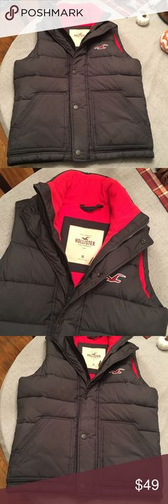 Men's Hollister Vest Coat Like new, bought for my son but apparently coats aren't cool in high school, so he never wore it. Fleece lined very warm. Dark gray with a red liner. Size medium.   Happy to bundle :)   All items come from a clean, non smoking home.   Check out my other items! Lots of Nike, Victoria Secret, Under Armour, Lululemon, American Eagle, J Crew, Athleta, Buckle & Miss Me items. Hollister Jackets & Coats Vests