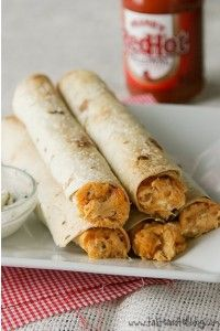 Recipe: Baked Buffalo Chicken Taquitos  Ingredients  	4 ounces cream cheese, softened 	1/8 cup buffalo sauce 	1 cup shredded Monterey jack cheese 	1/8 cup blue cheese crumbles 	1 can (12.5-ounce) Swanson Premium Chunk Chicken Breast in Water, drained 	8 8-inch flour tortillas 	coarse Kosher salt    Instructions  	Preheat the oven to 350°F. 	In a bowl, combine the cream cheese and buffalo sauce. Mix well. Stir in the Monterey ...