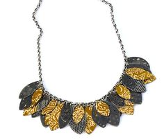 A perfect fall necklace! Darkened sterling silver and golden recycled tin can leaves. By Beth Taylor/A Quirk of Art.