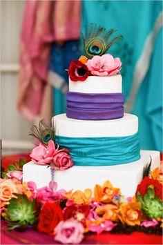 Festive peacock wedding cake #weddings #cakes #peacockblue #blue