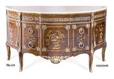 French earlier rococo, Louis XV style ormolu mounted commode after the model by Roger Lacroix under the direction of Gilles Joubert, Paris, 1769, inlaid with pictorial marquetry, eared marble topped, oval shape, classical motifs, large apron, fine ormolu mounts, three drawers and two doors, raised on ormolu mounted cabriole legs. The original piece was made in 1769 for the bedroom of Madame Victoire, daughter of Louis XV, in the royal château of Compiègne.. read more on antiquetaste website