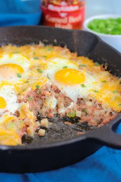 Southern Corned Beef Breakfast Skillet is a filling recipe for breakfast that every true Southerner will love. To make this recipe, begin by sauteing green peppers in a cast iron skillet before adding in a can of corned beef hash. Breakfast Hash, Breakfast Dishes, Breakfast Recipes, Breakfast Skillet, Breakfast Casserole, Breakfast Ideas, Canned Corned Beef Recipe, Corned Beef Recipes, Best Corned Beef Hash