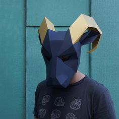NEED A FANCY DRESS COSTUME? Make your own RAM MASK from recycled card with these easy to follow instructions.  I have designed this set of templates and instructions so that you can create your own impressive 3D Low-Poly Ram Mask. The masks are designed to be easy to build so you dont need to be some sort of arts and crafts wizard and the finished masks are robust so should survive the wildest of parties. They are ideal for wearing to festivals, parties and even weddings! Not sure if you…
