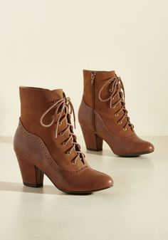 From the Same Cloth Boot in Caramel. You and your bestie have a ton in common, including a passion for these heeled ankle boots by B.A.I.T.  #modcloth