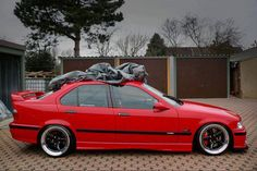 Hellrot BMW e36 sedan on blacked AC Schnitzer type 1 racing wheels