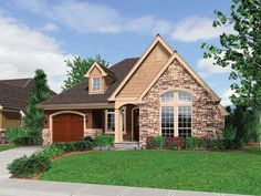 Vaulted ceilings add a spacious feel in this 3 bedroom Cottage home.  Cottage House Plan # 441093.