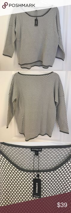 NWT Express grey and white polka dot sweater NWT Express grey and white polka dot sweater. This sweater has a crew neck and is slightly longer in the back than the front for a great, professional look Express Sweaters Crew & Scoop Necks