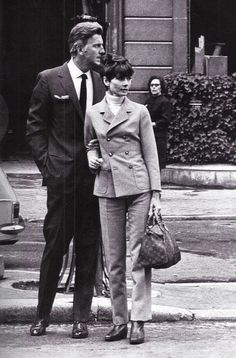 The actress Audrey Hepburn photographed with her beloved friend Hubert de Givenchy after a lunch in Paris (France), in April 1967. Audrey was wearing: • Suit: Rose Bertin (of caramel twill, blazer...