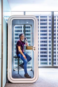 Modern Office Phone Booth for privacy. This Focus Booth includes seat, work surface, light, & ventilation. If you wonder if it works, it does. We tested it by screaming outside of it & when you were inside it, you couldn't hear anything. Very cool!