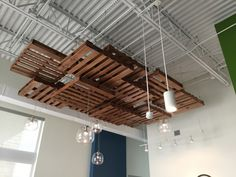 suspended ceiling made of pallets, neutral walls.....
