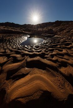 The sun setting over dried mud formations, Valley of Fire State Park, USA.