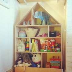 DIY storage shelves for kids - cute house shaped shelving made from plywood - gorgeous