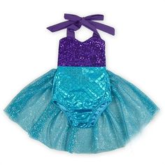 Adorable dark purple sequin romper with ribbon straps that tie in the back and spandex mermaid fabric featured on the bottom. Perfect for any mermaid birthday party, pool party, pictures, photo shoot,