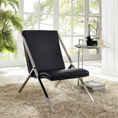 Swing Vinyl Lounge Chair, Black - Rock back and forth while seated stationary in the Swing lounge chair. Swing's design is a celebration of expanses of linear and curved space for a singular effect that imparts one pleasing result. From the polished stainless steel frame to the padded vinyl seat and back, Swing attracts attention without encumberment. Through and through, Swing is a minimalistic modern lounge chair. But even though the design is fluid and visually captivating, there is none…