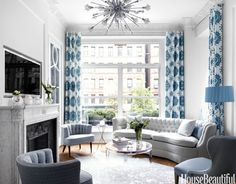 Conjuring a romantic past inside her no-frills Manhattan apartment, Kelly Giesen deployed architectural salvage, including windows and doors. A Plaza Hotel mantel adorns a faux fireplace below the flat-screen TV. Glamour radiates from the vintage chandelier and seating, a Plexi-Craft table, a metallic cowhide rug, and curtains in Sultan Suzanni linen by Martyn Lawrence Bullard Design.