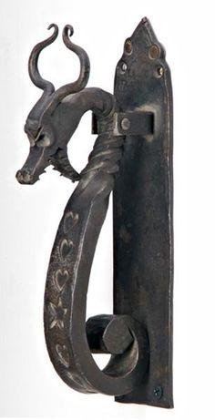 147: STYLE OF SAMUEL YELLIN Cast-iron door knocker shap