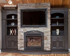 Check out the rustic, rubbed off finish that was used on this amazing fireplace design. It really compliments the paneled ceiling and stacke...
