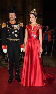 Denmark's Crown Princess Mary, looked radiant in a satin red dress, which nipped in at the waist and featured a sweetheart neckline. She completed her glamorous look with an exquisite Ruby Parure tiara and matching pair of diamond and ruby earrings, who joined her husband Crown Prince Frederik, for the traditional New Year's reception at Amalienborg Palace on January 1, 2018