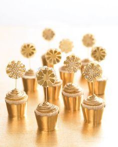 Flower pinwheels atop tiny gold luster-dusted, espresso-flavored cupcakes