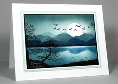 handmade card: Surreal Moonlight by labullard ... masking and brayering for this moonlit lake scene ..,., stamped flying geese and pine trees ... luv the reflections in the lake .,.. surreal because there are mountains behind the moon ... evening blues ... beautiful card ...