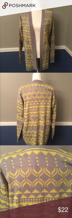 Yellow/grey long cardigan Tribal pattern. Yellow and grey cardigan. Worn once maybe twice. Fabulous condition. Perfect for fall. Sweaters Cardigans