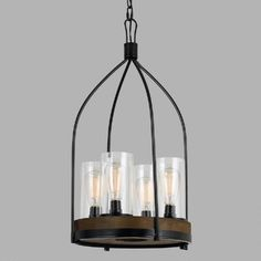Featuring four glass shades in an open, industrial-style iron cage with a rustic wood base, our mixed media pendant is an eye-catching lighting centerpiece for any room.