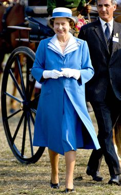 1988 Queen Elizabeth attended the Royal Windsor Horse Show in a bright cobalt blue dress, coat and sunhat.