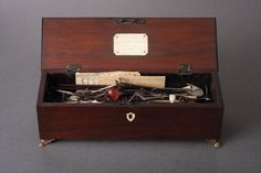 A Superb and Rare Collection of 28 Steel and Wood Scale Model Whaling Instruments  Contained in their original mahogany box with a silver plaque on the inner lid inscribed: 'A Model of Instruments and Apparatus used in Greenland Whale Fishery. Made by T Piercy 1820'  Some implements with their own steel labels attached: 'Flinching Spade', 'Spear Harpoon', 'Strand Knife', etc.  Circa 1820   Size: 9.5cm high, 30cm wide, 10cm deep – 3¾ ins high, 11¾ ins wide, 4 ins deep