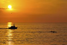 Boat and Kayakers at Sunset in Oceanside - February 21, 2014 by Rich Cruse on 500px